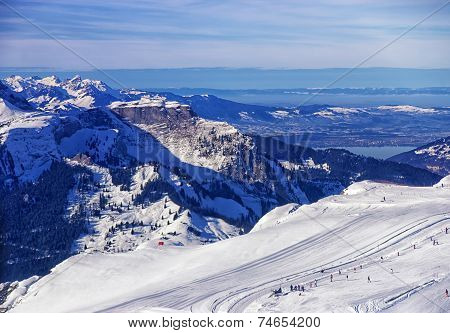 Helicopter View To The Winter Sport Resort In Swiss Alps
