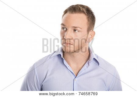 Pensive and unhappy isolated young blond businessman in blue shirt looking sideways to text.