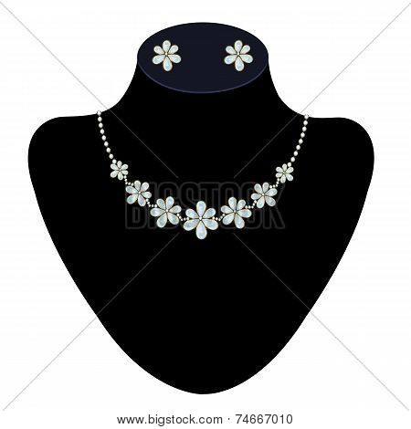 Necklace and earrings on a mannequin
