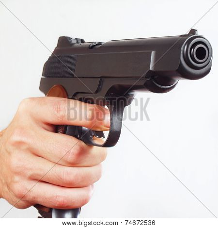 Hand with army semi-automatic gun close up