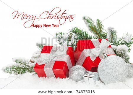 Christmas baubles and red gift boxes with snow fir tree. Isolated on white background with copy space