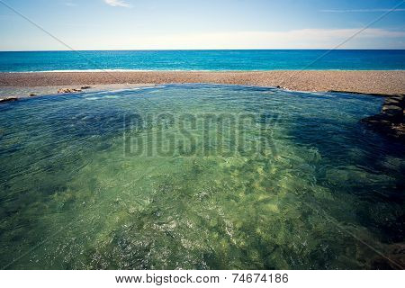 Natural pool and river in front of the sea on Playa San Rafael Dominican Republic