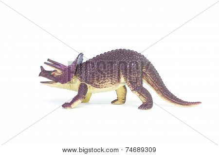Triceratops dinosaur toy on white background