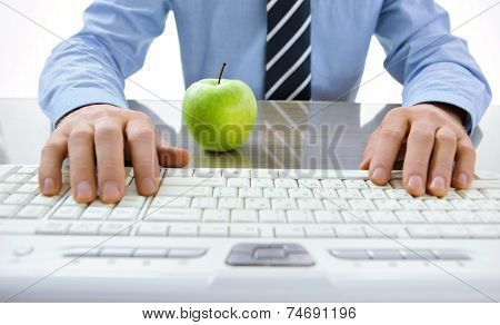 Typing male hands. Nature and technology concept