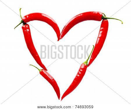 Heart Made Of Red Chili Peppers On White