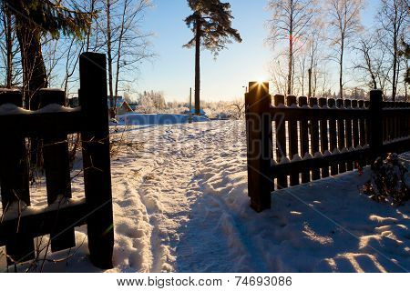 Wooden fence and footpath at winter
