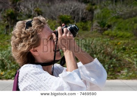 Woman Photographer in Action