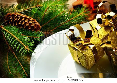 Closeup Christmas Plate Golden Gifts Pines Wooden Surface