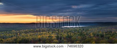 Fall forest trees and sunset viewed from Lookout trail in Algonquin Provincial Park, Canada.