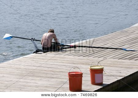Sculler Resting At The Dock