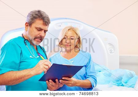 Medical Staff Filling Application Form For Ct Scanner Procedure