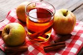 picture of cider apples  - Apple cider with cinnamon sticks and fresh apples on wooden background - JPG