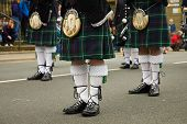 picture of kilt  - Three persons in typical scottish Kilt Dress