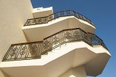 foto of bannister  - Spiraling staircase on outside of a large building - JPG