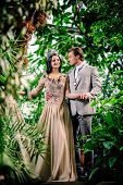 stock photo of tiara  - Gorgeous lady in long evening dress and with tiara on a head and handsome man in classic suit - JPG