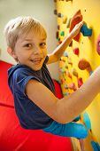 picture of climbing wall  - Happy boy on the climbing wall vertical - JPG
