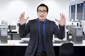 picture of unbelievable  - Portrait of asian entrepreneur with shocked expression face shot in the office - JPG