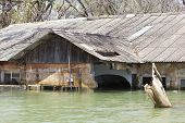 image of flood  - A flooded hotel resort at Lake Baringo in Kenya. Many resorts where destroyed when the lake water level unexpectedly rose by four meters in 2012 and 2013. ** Note: Shallow depth of field - JPG
