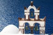 stock photo of blue-bell  - Ancient bell tower over the blue sea Santorini Cyclades Greece - JPG