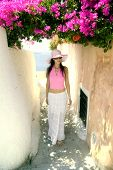 pic of greek-island  - Beautiful young Greek woman on the streets of Oia - JPG
