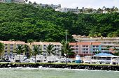 stock photo of conquistadors  - Tropical guest rooms and boats docked in front while the waves hit the levy at la Marina in Fajardo Puerto Rico - JPG