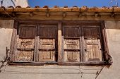 foto of gutter  - Old wooden window with rain gutter and clothes dryer - JPG