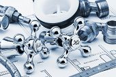 picture of mechanical drawing  - plumbing and tools lying on drawing for repair - JPG