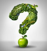 foto of fruit  - Green diet questions concept as a group of fresh fruit and vegetables in the shape of a question mark as a symbol of good high fiber healthy eating and information on natural nutrition - JPG