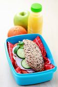 stock photo of lunch box  - lunch box with delicious sandwich and fruits - food and drink