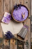 stock photo of sachets  - Spa advertisement with lavender salt soap and sachet - JPG