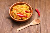 foto of tabouleh  - Couscous with vegetables on a bowl on wooden table - JPG