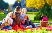 stock photo of recreate  - happy family on autumn picnic in park - JPG