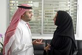 picture of arabian  - Arabian Business man having a discussion with an arabian businesswoman in the office - JPG