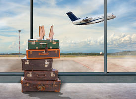 stock photo of lifting-off  - View of luggage in the airport in the interim airplane take off - JPG