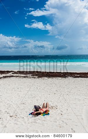 Young Fashion Woman Relax On Caribbean Beach Of Tulum, Near Playa Del Carmen, Traveling Mexico. Amer