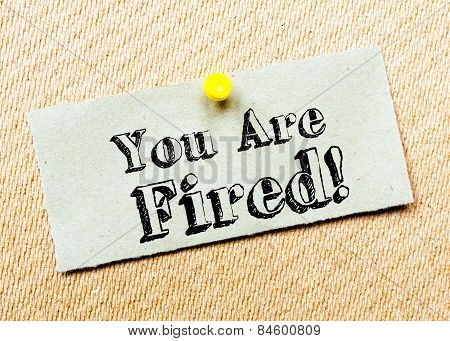 Recycled Paper Note Pinned On Cork Board. You Are Fired Message