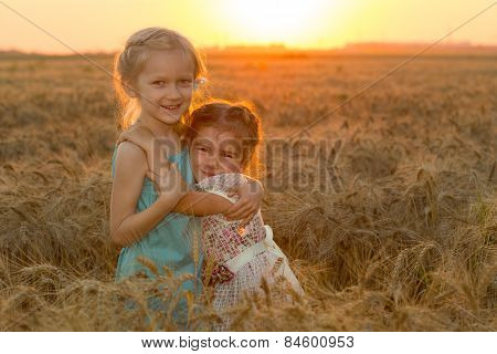 Two Child Girls At The Sunset Field