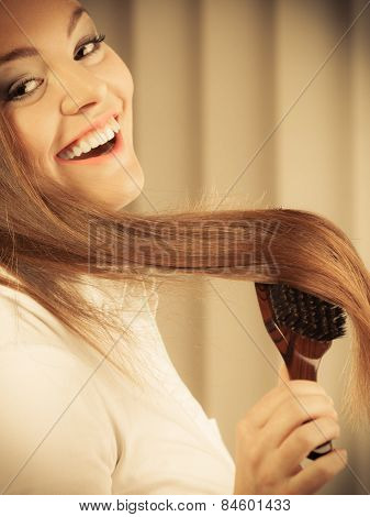 Beautiful Woman With Long Hair And Brush