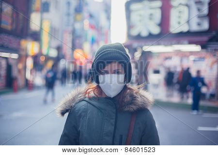 Young Woman With Face Mask In Japan