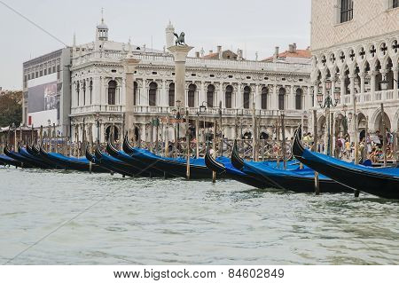 Row Of Gondolas Near Doges Palace In Summer Venice
