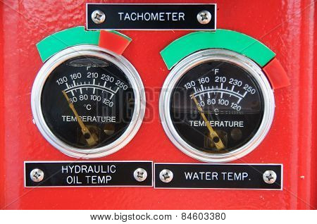 Meters or gauge in crane cabin for measure Maximun load, Engine speed , Hydraulic pressure