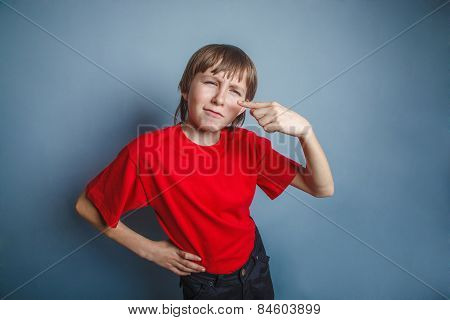 boy, teenager, twelve years in the red shirt, nose pimple proble