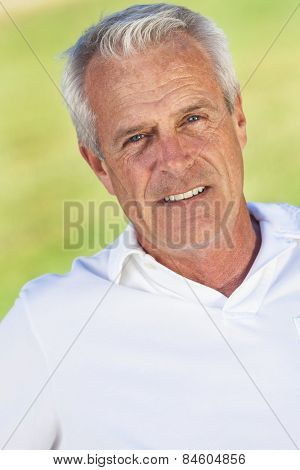 Portrait of happy and healthy senior man outside smiling and happy