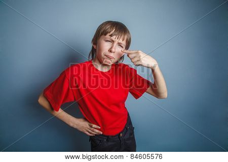 boy, teenager, twelve years in  red shirt, nose pimple problem s