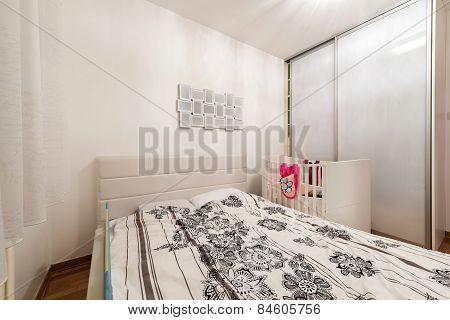 Bedroom Interior With Crib