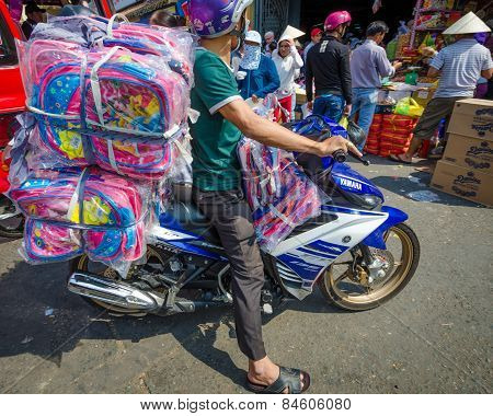 Motorcycles are the main mode of transporting goods in Saigon