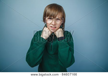 boy teenager European appearance in retro dress with glasses hol
