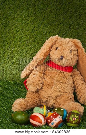 Rabbit, Sit On Green Grass With Group Of Colorful Eggs, Can Use As Background For Happy Easter Festi