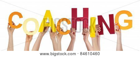Many People Hands Holding Colorful Word Coaching