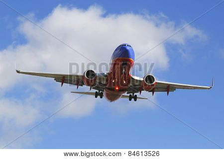 Southwest Airlines jet descending for landing San Diego International Airport.
